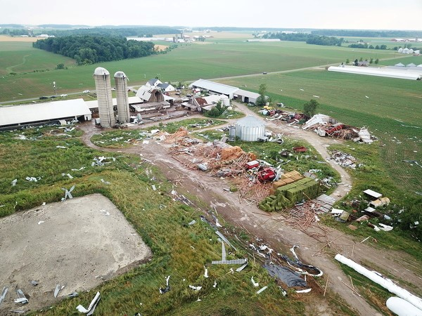 Photo by Ryan Snyder/The Daily Standard. Several machine sheds and hay storage buildings were destroyed at this dairy farm near the intersection of Fox and Meiring roads Friday afternoon when a tornado touched down near Fort Recovery. The house and main cow barn are still standing.