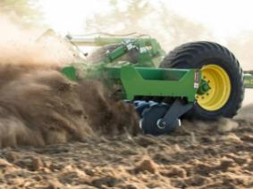 piece of tillage equipment being pulled across field