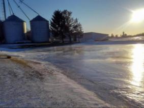 Grain bins at sunset